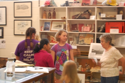 (from left) Deanna McKinney, Lynda Pedro and Naomi Cummings explore the Collinsville History Museum with Rebecca Clayton.