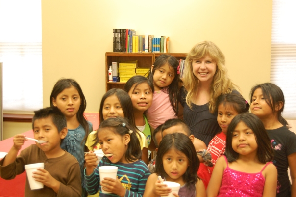 "Mary Beth Snow poses with some of the children who attending her ""Reading Party."""